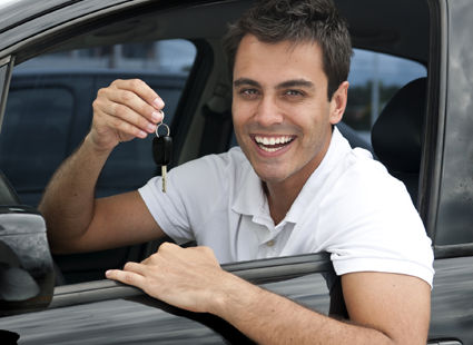 Man with new car financed with an auto loan