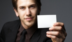 Man offering blank business card