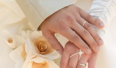Two hands with wedding rings on