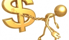 Man tied to a dollar sign by a chain