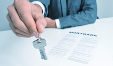 mortgage loan hand with keys