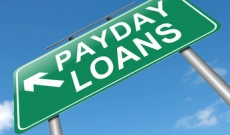 Payday loan sign against sky