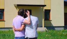Same sex couple viewing home