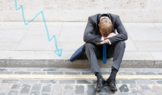 Stock broker sitting on curb