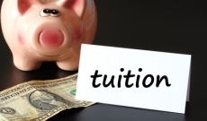Piggy bank with note saying tuition