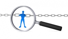 Magnifying glass on a man holding two chains together