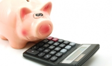 Piggy bank calculating auto loans