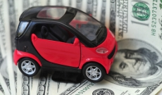 smart car on hundred dollar bills