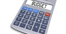 "Calculator displaying the word ""budget"""