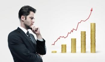 Businessman increasing bar graph