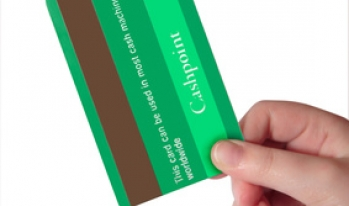 Hand holding green credit card