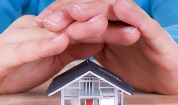 Hands over small house