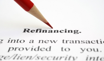 """Pencil pointing at """"Refinancing"""" definition"""
