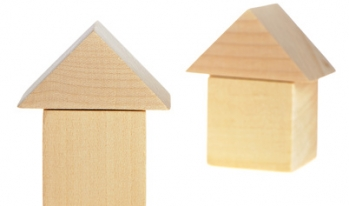 Two houses made of wooden blocks