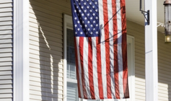 American flag hanging in front of a home