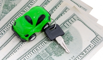 car and keys on top of money
