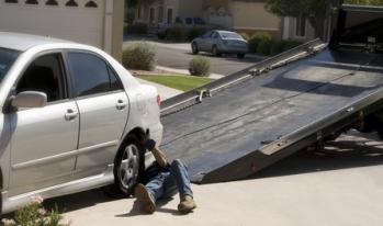Repo man repossessing a vehicle