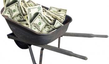 cash money in a wheelbarrow