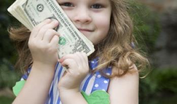 little girl holding cash money