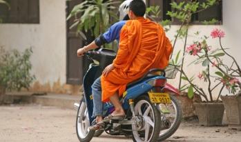 Monk riding motorbike in Thailand