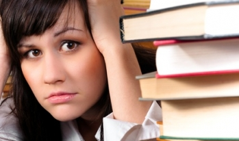 Stressed student with text books