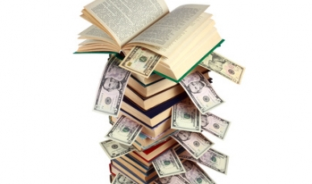 Text books filled with student loan debt