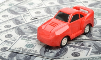 toy car on hundred dollar bills