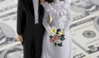 Bride and Groom figurines on five dollar bills
