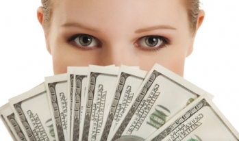woman with money in front of her face
